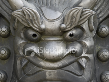 Iron face statue at Tenryuji Temple on Shutterstock.com