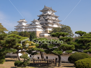 Himeji Castle main tower with bonsai pine trees on Shutterstock.com