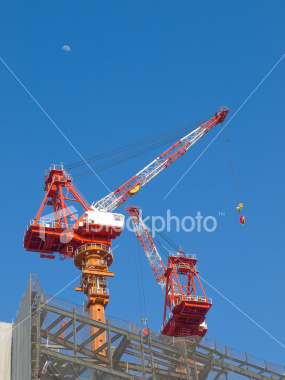 Construction cranes in Umeda on Shutterstock.com